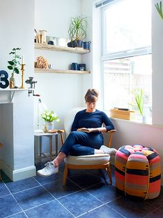 Credit: Ingrid Rasmussen Murphy sits in a vintage Ercol armchair (try eBay); the table lamp behind her is Hector by Original BTC. She uses her own fabrics at home, but the brightly coloured pouffe is from Liberty.