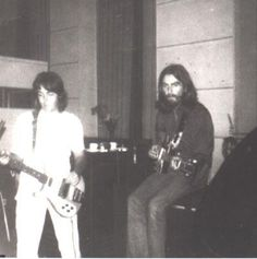 """The first photograph shows the two Beatles in their """"normal"""" positions.  McCartney on bass, Harrison on guitar.  But they obviously would change-up occasionally.  Harrison with a Fender bass that he played on much of side two's """"medley"""", and McCartney with his favorite Epiphone Casino electric guitar."""