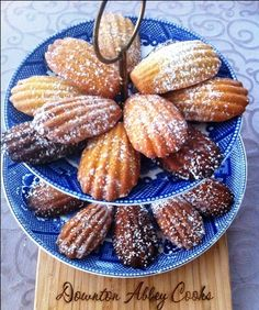 Madeleines (Pronounced: mahd lehn) are little cakelike cookies that are baked in special molds that give them a delicate shell shape. They date back to 1755 in the the court of Louis XV, reportedly prepared in honor his father in-law's cook Madeleine Paulmier.  Try these lower fat recipes for plain, chocolate and earl grey versions.