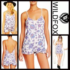"WILDFOX Ruffle Floral Romper NEW WITH TAGS Retail: $118  WILDFOX Ruffle Romper  * Adjustable thin straps & V-neck front  * Ruffle trim detail   * A stretch-to-fit and pull-on style  * It measures about 27"" long, w/a approx. 2.5"" inseam  * Allover print w/a subtly washed look   Fabric: 100% Rayon  Color: Multi Patterned Floral Print  Item: 94500  No Trades ✅ Offers Considered*✅  *Please use the blue 'offer' button to submit an offer. Wildfox Dresses Backless"