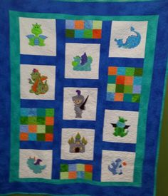 Dragons and knight quilt using embroidery machine for squares.   I used minky for the applique to add texture for a baby to feel.