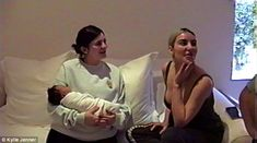 Aww: Kylie Jenner is shown holding baby Chicago West who is seen for the first time after Kim Kardashian and Kanye West welcomed her last month