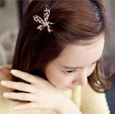 11508Daisies bow flowers Leopard hairpin
