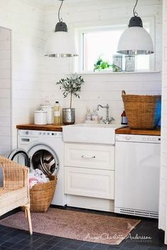 Love the sink in this small laundry room! Very rustic and farmhouse feel to it.