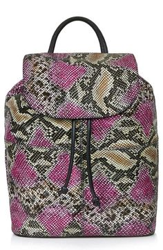 Topshop Snakeskin Print Leather Backpack (Brit Pop-In) at Nordstrom.com. Supple, grained leather in a color-popped snakeskin print is shaped into an eye-catching backpack fully loaded with convenient features. The front flap is secured with a magnetic closure and drawstring ties for added security, while adjustable straps and a handle attachment on top make for versatile wearing options.