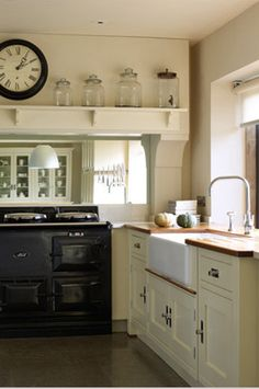 Love the giant jars. Cream Country Kitchen with Black Aga - Martin Moore. Big clock in kitchen, nice. Aga Kitchen, Kitchen Dining, Kitchen Decor, Kitchen Ideas, Open Kitchen, Cream Country Kitchen, Country Kitchen Designs, Country Kitchens, Handmade Kitchens