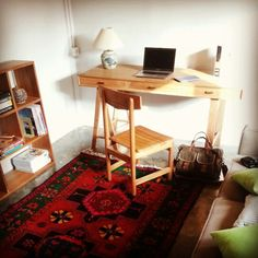 Home office idea with a colorful Armenian rug as an accent. Desk, chair, and bookshelf by Kekayuan.