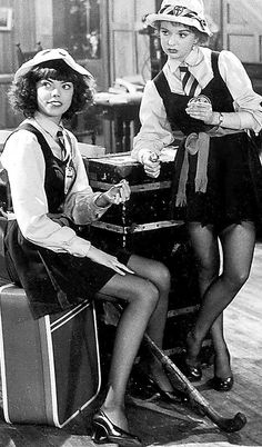 St Trinian's sixth formers guarding the crooks they overpowered and tied up in the original film series St Trinians, School Uniform Girls, Girls Uniforms, 1940s Woman, Submissive Wife, Brave Women, Stockings And Suspenders, Child Actors, Retro Look