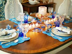 Blue Hanukkah Table Decor ll This table uses several shades of blue together, from cobalt to cornflower to navy. As long as blues are in the same family, they will work well together. #Interiors #Decor #Blue fairylights.com