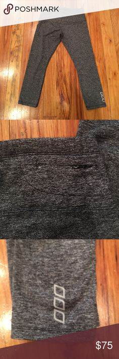 Lorna Jane crop/ 7/8 leggings Grey workout pants with zipper pocket in the back for keys, lipstick,etc.... it has inner drawstring to tighten the waist if needed. EUC Lorna Jane Pants Leggings