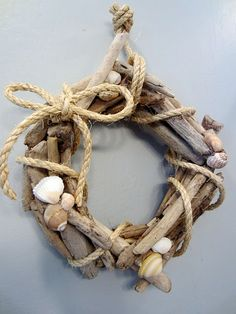 Wreath idea for the cottage...maybe using silk rope? Feeds my love of all things nautical