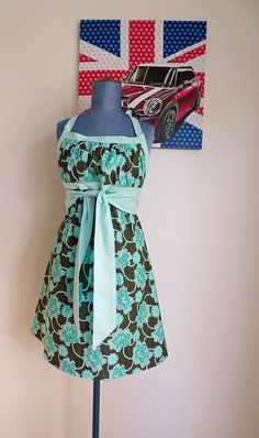 I loved this apron when I saw the pattern, and I still love it. I may have to put some of my spending cash towards buying fabric for this apron next month.
