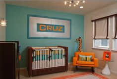 Love the blue, orange, and chocolate brown color scheme. Retro Modern Nursery in OC Residence by Little Crown Interiors