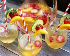 This white wine sangria is the perfect way to cool off on a hot summer day! Peach Wine, Peach Drinks, White Wine Sangria, Peach Sangria, Strawberry Sangria, Sangria Recipes, Cocktail Recipes, Wine Recipes, Cooking Recipes