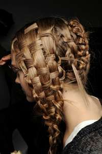 Alexander McQueen. one day i want to have my hair like this. yessss