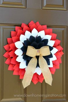 Amazing Wreath Crafts for of July. Looking to decorate your front door with a little red, white and blue magic? These amazing patriotic wreath ideas and spectacular. Patriotic Wreath, Patriotic Crafts, Patriotic Decorations, 4th Of July Wreath, Wreath Crafts, Diy Wreath, Paper Crafts, Paper Wreaths, Wreath Ideas