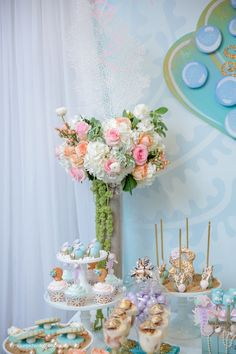 Gorgeous floral accents from Pastel Mermaid Birthday Party at Kara's Party Ideas. See the ocean of details at karaspartyideas.com!