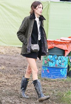 Alexa Chung paired a feminine blouse and shorts with festival essentials, like her Barbour jacket and wellies at #Glastonbury 2011 // #CelebrityStyle