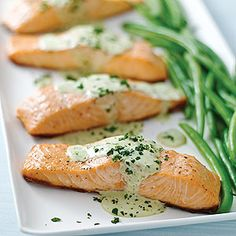 Served this on a bed of steamed spinach with pine nuts sprinkled on top - salmon with creamy pesto sauce - YUM!