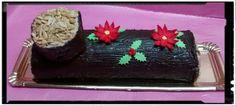 Tronco de Navidad con crema de oreo y chocolate con almendra caramelizada.