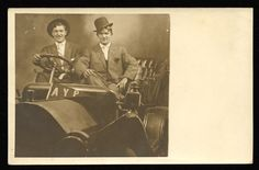 [Two men posing for a photograph in an automobile with an AYP banner at the Alaska-Yukon-Pacific Exposition, Seattle, Washington, 1909]