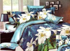 Niebieska pościel do sypialni w białe kwiaty
