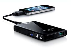 PORTABLE PROJECTOR | BY SHOWWX  This is the new Microvision Showwx projector, it´s sleek, slim portable laser protection and fits in your pocket, it´s as small as your mobile phone. It works with some of your favorite gadgets, phone, ipod, itouch and you can also connect it to your laptop, or any other device that has a TV-Out or VGA functionality.