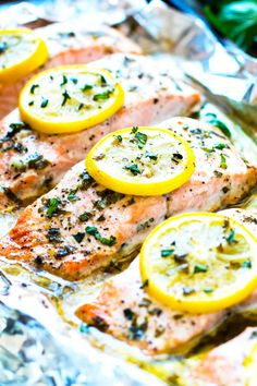 Basil & lemon baked salmon in foil is a healthy and easy and healthy salmon recipe that is a low-carb, Paleo and gluten-free dinner for the whole family. Lemon salmon can be on the table in under 30 minutes!