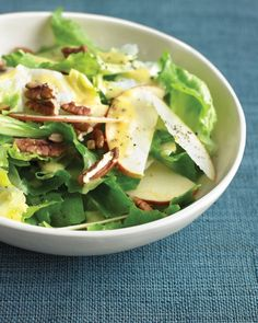 Sliced apple, toasted pecans, and escarole leaves make a pleasing combination of flavors and textures. The salad is tossed with white-wine vinegar and Dijon mustard dressing.