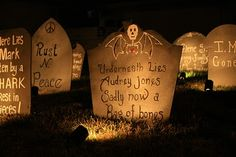 DIY Light Up Cemetery Halloween Yard Decor -- Cheap and easy! I used soup cans so they would be more sturdier. They worked out GREAT!!