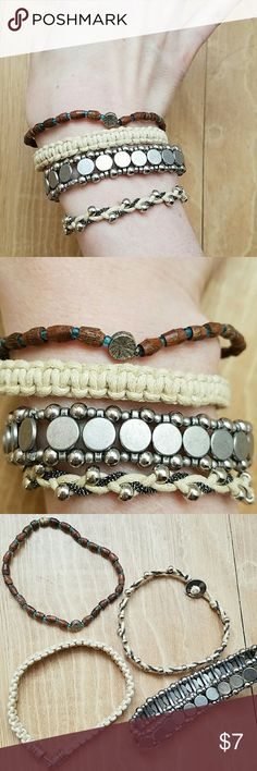 Bundle of 4 American Eagle casual bracelets Set of 4 bracelets from American Eagle, can be worn together or separately. One is all silver and fairly substantial, looks great alone. Dark bracelet is wood beads with small blue beads between, one raffia-rype bracelet and the last is a braided bracelet with silver accent beads. All 4 in excellent condition. Feel free to ask questions! American Eagle Outfitters Jewelry Bracelets