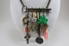 Handcrafted Vintage Charm Necklace - Key To My Childhood by cybersenora on Etsy https://www.etsy.com/listing/84998641/handcrafted-vintage-charm-necklace-key