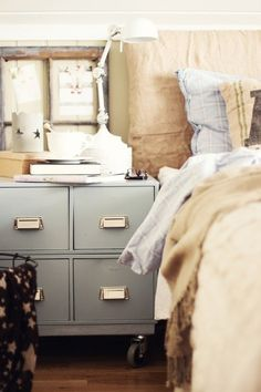 A File cabinet painted powder blue and used as a nightstand - brilliant!