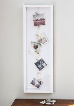 Twine Goes By Photo Frame, #ModCloth. Use metal hooks and tie twine onto fridge. One hook on bottom and one hook on top.