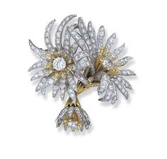 "A DIAMOND ""BLOOMING DAISY"" BROOCH, BY JEAN SCHLUMBERGER, TIFFANY & CO.  Designed as a pair of flower heads, each centering upon a circular-cut diamond and gold wirework pistil, with circular-cut diamond sepals, to the circular-cut diamond petals, suspending a   smaller bud of similar design, mounted in platinum and gold"