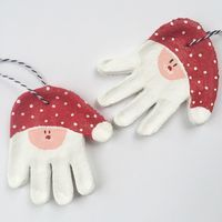 Salt Dough Handprint Santa Ornaments | Momma Society-The Community of Modern Moms | www.MommaSociety.com