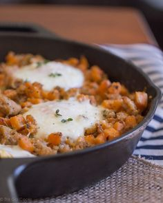 Sausage and Sweet Potato Hash with Baked Eggs - This Gal Cooks. A savory breakfast dish made with chicken sausage. | #inspirationSpotlight