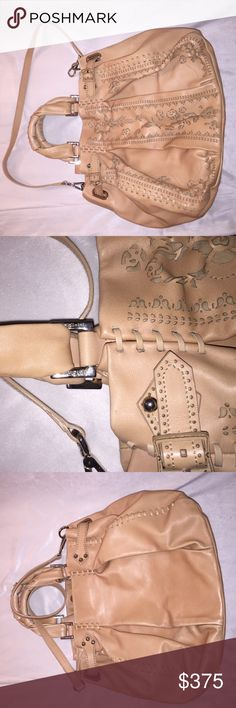 Italian designer Handbag Italian designer Baldinini handbag. Hand stitching and hand carved Lester motifs. Beautiful cream beige color- with shoulder strap. 100%leather. Bought is in Milan a few years back and barely worn it- it's a bit too large for my taste. Baldinini Bags Satchels