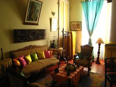 """In this old family house, there is the delicate parfume of """"old Pondy"""". You can found a lot of antiquities particulary in the decoration of the """"Suite Coloniale""""."""