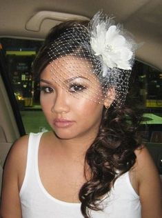 only with the hair coming down on the other side of the neck.  wedding hair with birdcage veil - Google Search
