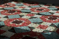 Little House Creations: Photos of more quilts. Do I have this red fabric. Like it with the blue.