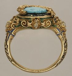 Alexander the Great (?) cameo ring | Date: mid-16th century | Culture: probably Italian | Medium: Turquoise, enamel, gold | Dimensions: Ring setting, overall: 1 x 1 1/16 in. (2.6 x 2.7 cm); visible cameo (confirmed): 11 x 9.6 mm | Accession Number: 10.110.2 #GoldJewellery16ThCentury