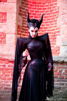 Devilish Beauty Maleficent Sleeping Beauty cosplay, I just love how she took Maleficent's fashion to a whole new level!  That corset, the hair and horns,  those shoulder caplets are awesome!