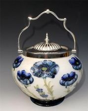 "WILLIAM MOORCROFT MACINTYRE "" POPPY "" BISCUIT BARREL WITH ELABORATE SILVER MOUNT"