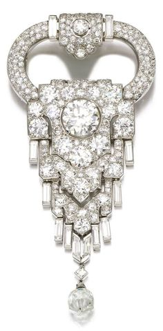 An Art Deco diamond brooch, Cartier, circa 1925. The pavé-set surmount supporting articulated plaques set with circular-, single-, square-cut and baguette diamonds, and a briolette drop, detachable brooch fitting, signed Cartier, French assay marks.