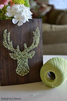 Cool lime green threaded stag silhouette on wooden planter / deco box