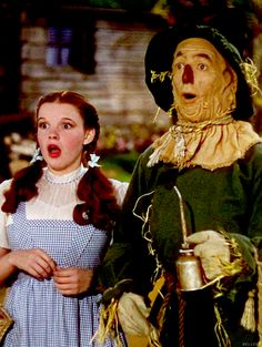 """Dorothy and The Scarecrow meet The Tin Woodsman on the way down the Yellow Brick Road. """"The Wizard Of OZ"""" - Judy Garland & Ray Bolger, 1939."""
