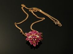 An 18ct gold ruby and diamond foliate pendant necklace