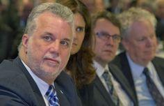 Le premier ministre Philippe Couillard aux côtés du ministre Jean D'Amour et de l'ancien premier ministre Jean Charest, lors de l'événement Objectif Nord, mardi à Montréal.