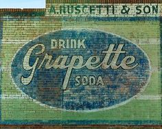 "Vintage Grapette wall sign in Camden, Arkansas ~  The Grapette Company was founded in 1939 with two great tasting sodas, Grapette and Orangette. These were their flagship flavors. These sodas are still being produced today in Malvern, Arkansas under the brand name ""Sam's Choice"" sold only at the Wal-Mart stores.   #South #Southern"